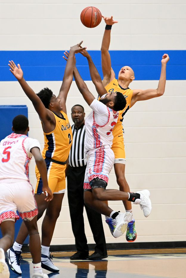 Faith Family's Jordan Walsh, back right in yellow, blocks a shot by Carter's Walter Taylor III (32) in the second half during a Class 4A Region II final boys playoff basketball game between Dallas Carter and Oak Cliff Faith Family, Friday, March 5, 2021, in Grand Prairie, Texas. (Matt Strasen/Special Contributor)
