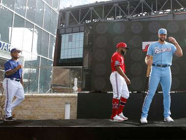 Texas Rangers Joey Gallo (right), Delino DeShields (center) and Willie Calhoun (left) on stage during the unveiling of the 2020 uniforms at Live! next to Globe Life Field in Arlington, Texas on Wednesday, December 4, 2019.