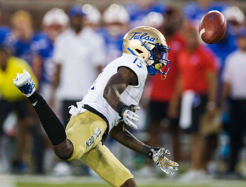 Tulsa Golden Hurricane wide receiver Josh Johnson (13) misses a pass that was immediately intercepted by SMU Mustangs cornerback Chevin Calloway (11) during the first quarter of an NCAA football game between Tulsa and SMU on Saturday, October 5, 2019 at Ford Stadium on the SMU campus in Dallas. (Ashley Landis/The Dallas Morning News)