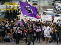 "Demonstrators march down Elm Street downtown during the Not My Son organization's ""100 Women March"" from Dallas City Hall to the Frank Crowley Courts Building on Friday, July 31, 2020.  Protests that began in the response to the death of George Floyd in late May continued in Dallas as the calendar moves from July into August. (Smiley N. Pool/The Dallas Morning News)"