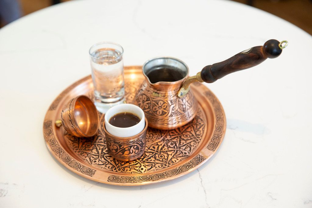 Turkish Coffee at Pax & Beneficia is served on plates sourced from Turkey.