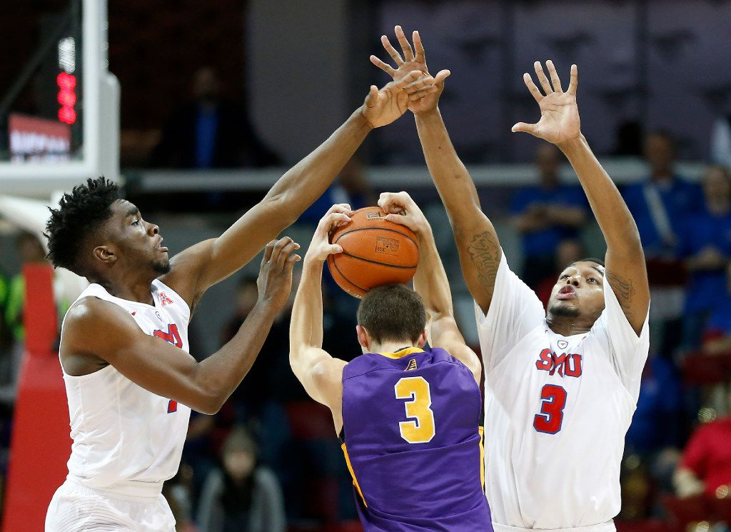 Albany guard Joe Cremo (center) is defended by SMU guard Shake Milton (left) and guard Sterling Brown during the second half at Moody Coliseum in Dallas, Tuesday, Dec. 20, 2016. The Mustangs won 71-53. (Jae S. Lee/The Dallas Morning News)