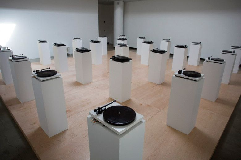"Dallas artist Lauren Woods' project ""American Monument"" has as its centerpiece an interactive sound sculpture in which turntables play audio recordings obtained through open-records requests, with each turntable representing one black person killed in an altercation with police."