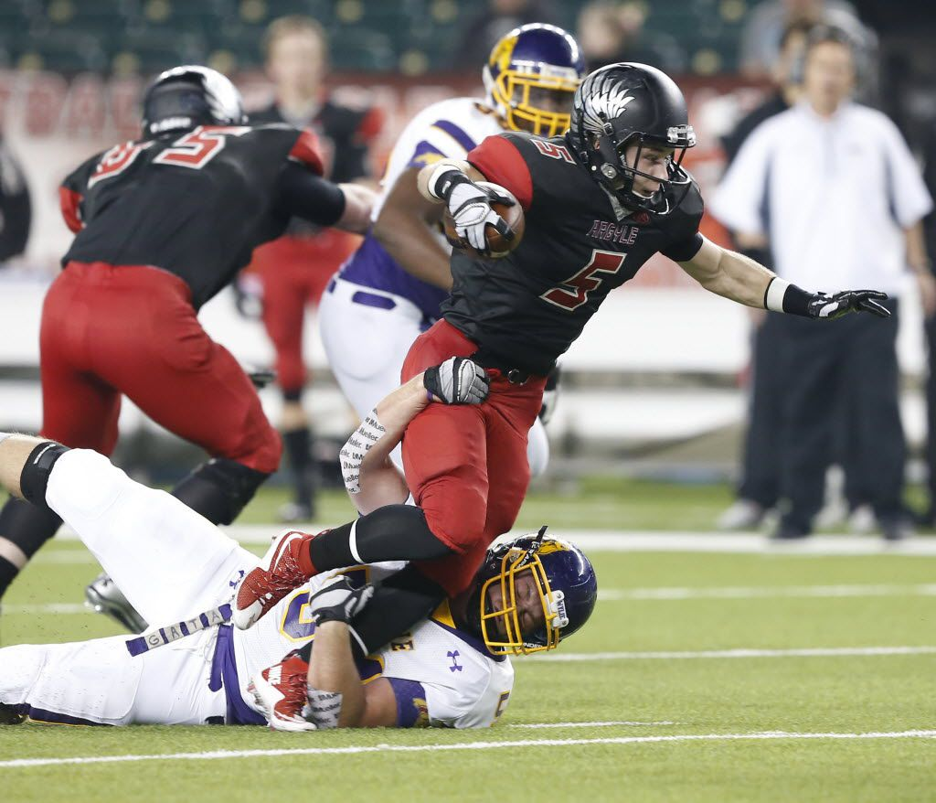Argyle Eagles Gage McCook (5) is tackled by Abilene Wylie Bulldogs Riley Hedge (54) during the first half of a 4A High School State Semifinals football game between Argyle Eagles Vs Abilene Wylie Bulldogs on Friday, December 11, 2015, in Waco, Texas. DRC Jose Yau