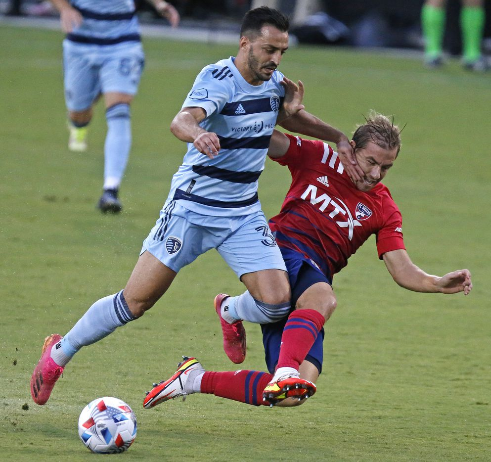 Sporting Kansas City defender Luis Martins (36) collides with FC Dallas midfielder Paxton Pomykal (19) during the first half as FC Dallas hosted Sporting Kansas City at Toyota Stadium in Frisco on Saturday evening, August 14, 2021. (Stewart F. House/Special Contributor)