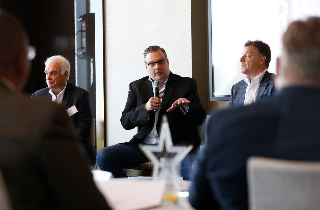 Texas Legends President Donnie Nelson (center) speaks during a panel that included Dallas Stars president Jim Lites (left) and Frisco RoughRiders CEO Chuck Greenberg at the U.S. Conference of Mayors Professional Sports Alliance at The Star in Frisco on April 7. (Vernon Bryant/The Dallas Morning News)