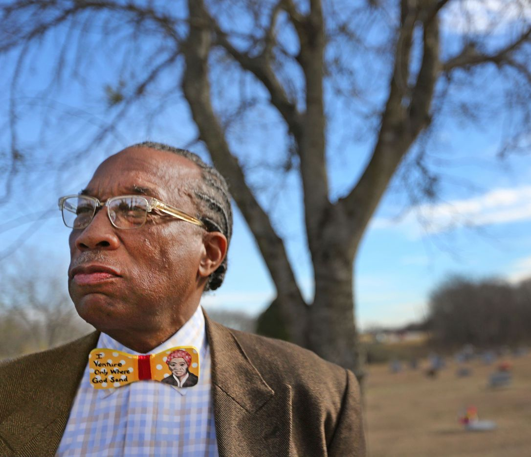 Sporting a bowtie adorned with the image of abolitionist Harriet Tubman, Dallas County Commissioner John Wiley Price revisits the black cemetery in his childhood home town of Forney, Texas.