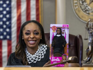 "Dallas County Criminal Court Judge Shequitta Kelly poses for a portrait with a Judge Barbie doll in her courtroom on Monday, November 11, 2019 at Frank Crowley Courts Building in Dallas.  ""Not only does this Barbie change the narrative for little black girls, it does the same for those of all races,"" Kelly said. (Ashley Landis/The Dallas Morning News)"