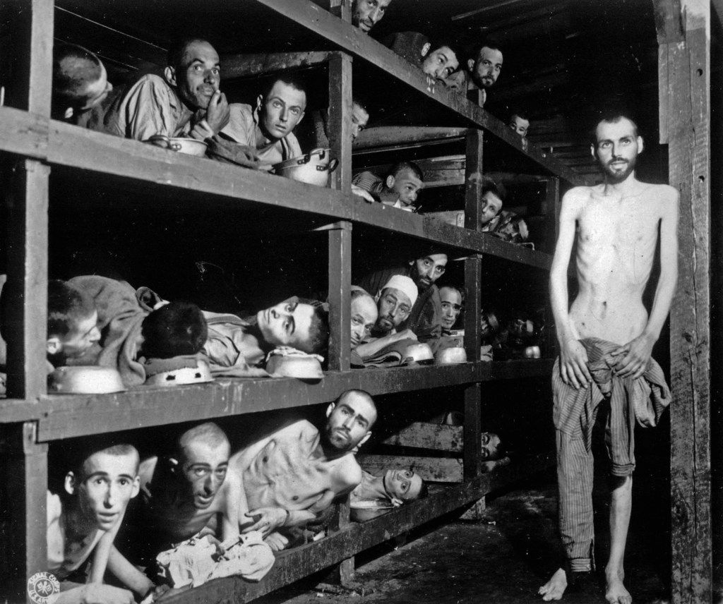 In this April 16, 1945  photo, inmates of the German KZ Buchenwald are seen inside their barracks a few days after U.S troops liberated the concentration camp near Weimar, Germany.