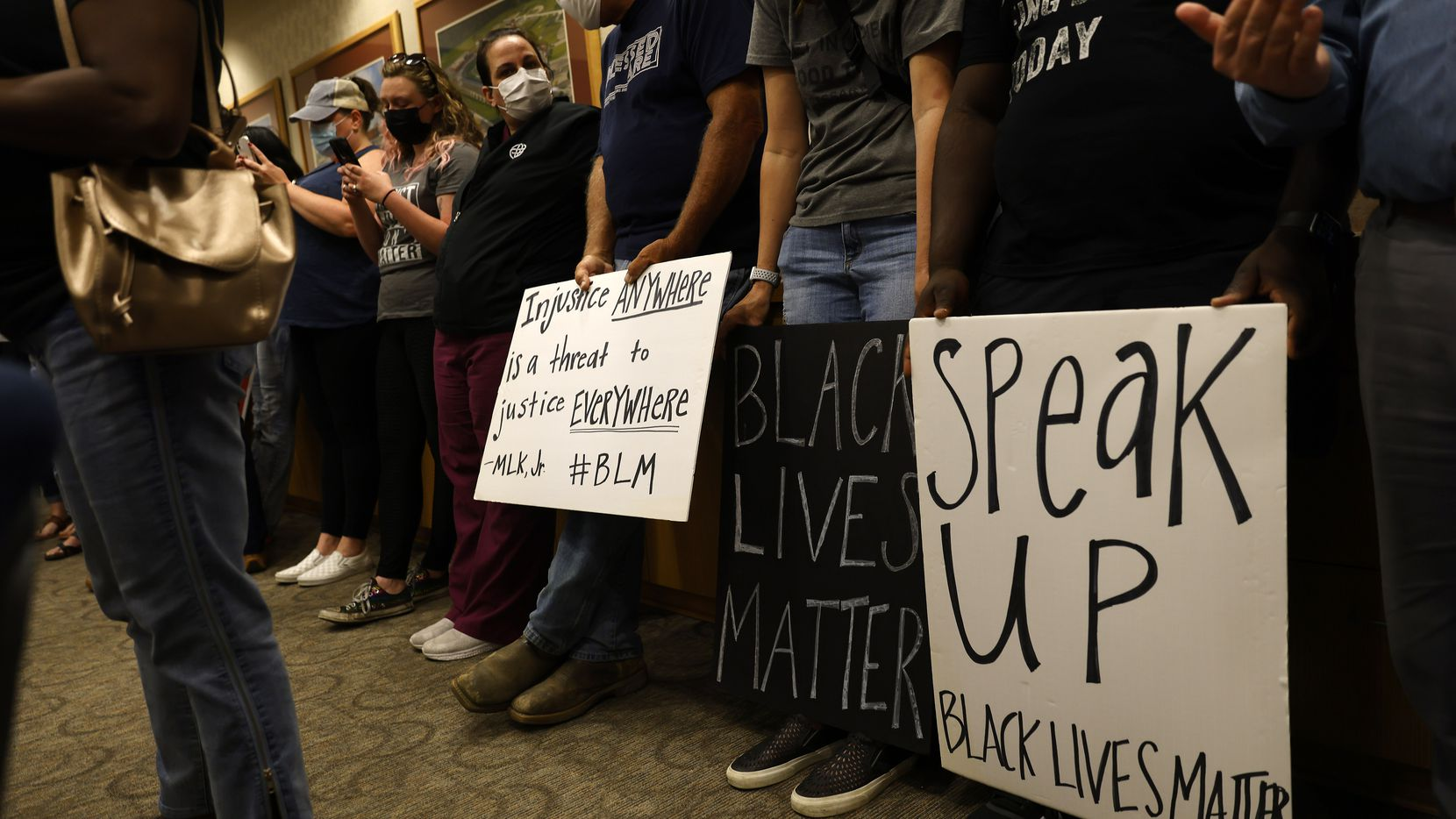"""Parents and supporters gathered in the Aledo ISD school board chamber to voice their concerns about a racist Snapchat group with multiple names, including """"Slave Trade"""" and another that included a racial slur."""