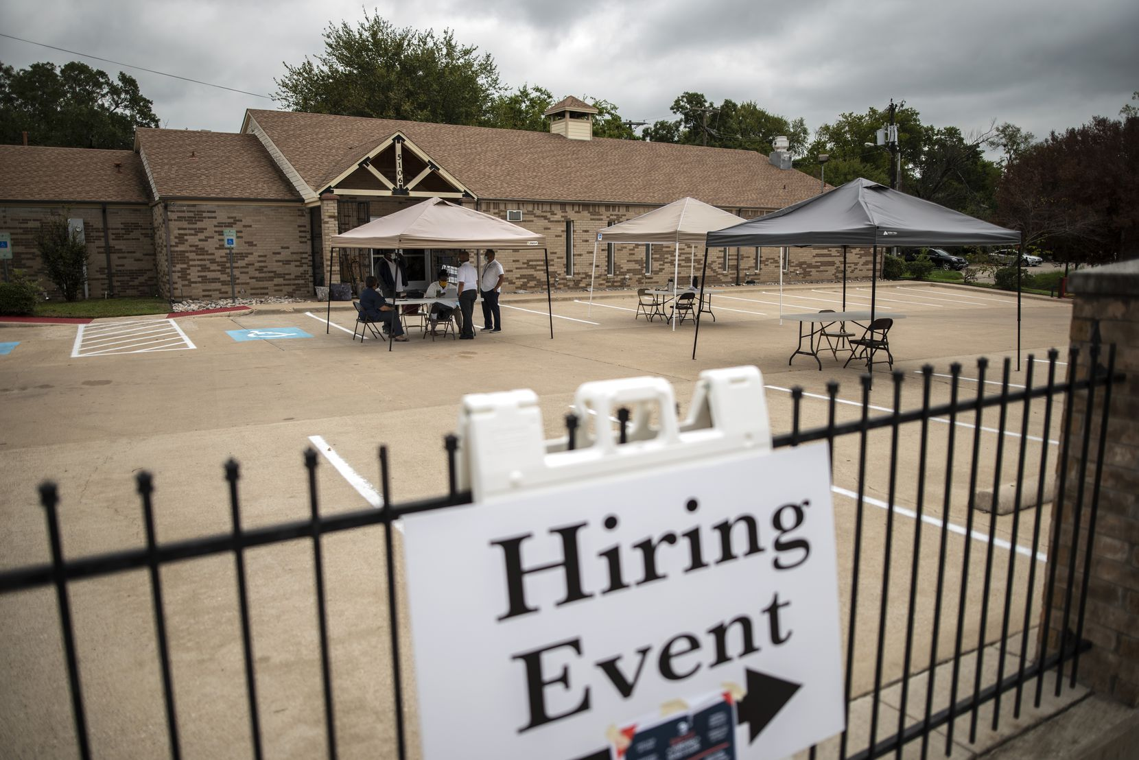 Employees of Workforce Solutions Greater Dallas prep for a virtual job fair hosted by the State Fair of Texas outside of the T.R. Hoover Center in Dallas, Wednesday, Sept. 23, 2020. Ben Torres/Special Contributor