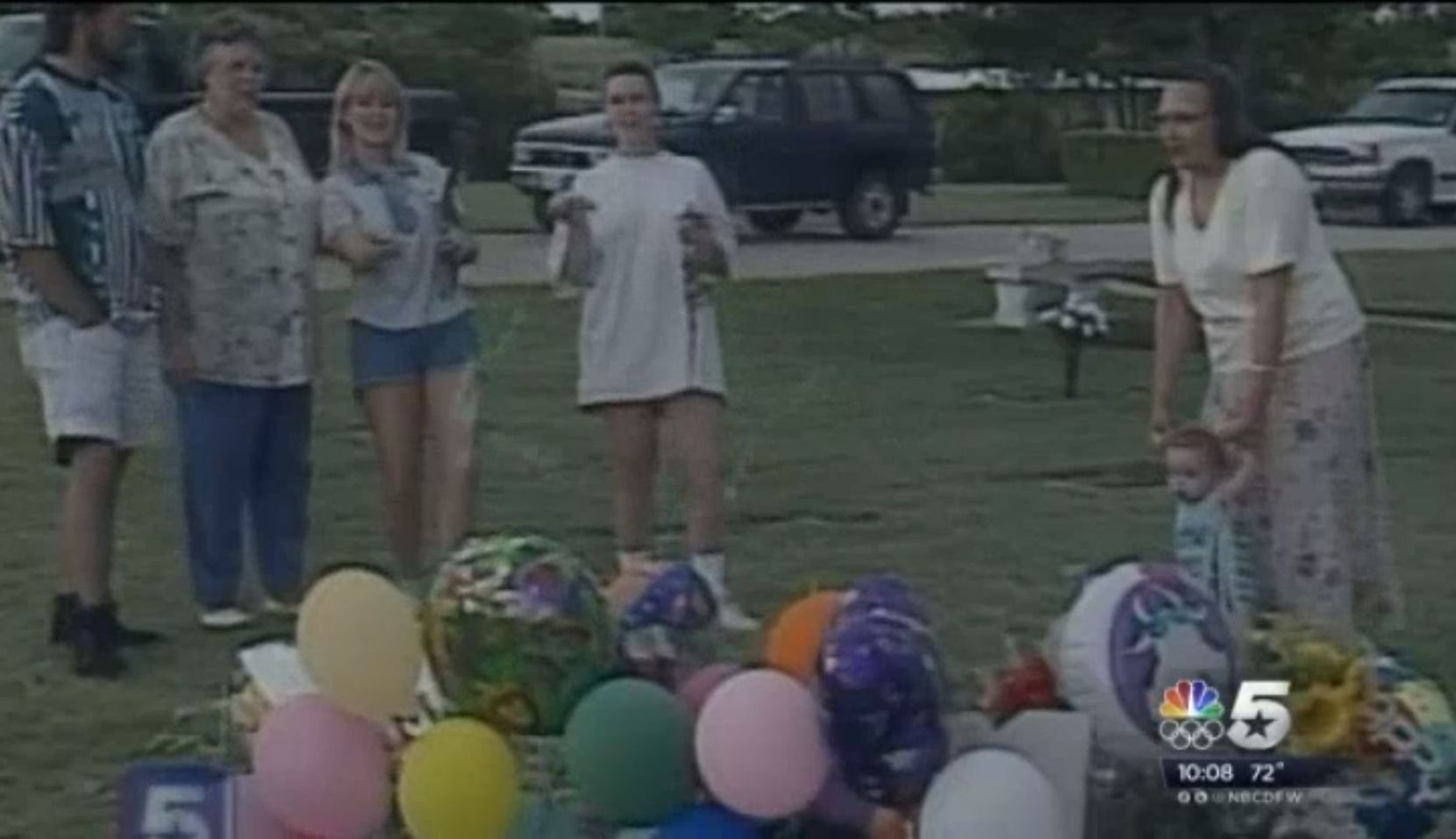 An image from a rebroadcast of the 1996 video NBC5 captured of Darlie Routier spraying Silly String on her sons' graves.