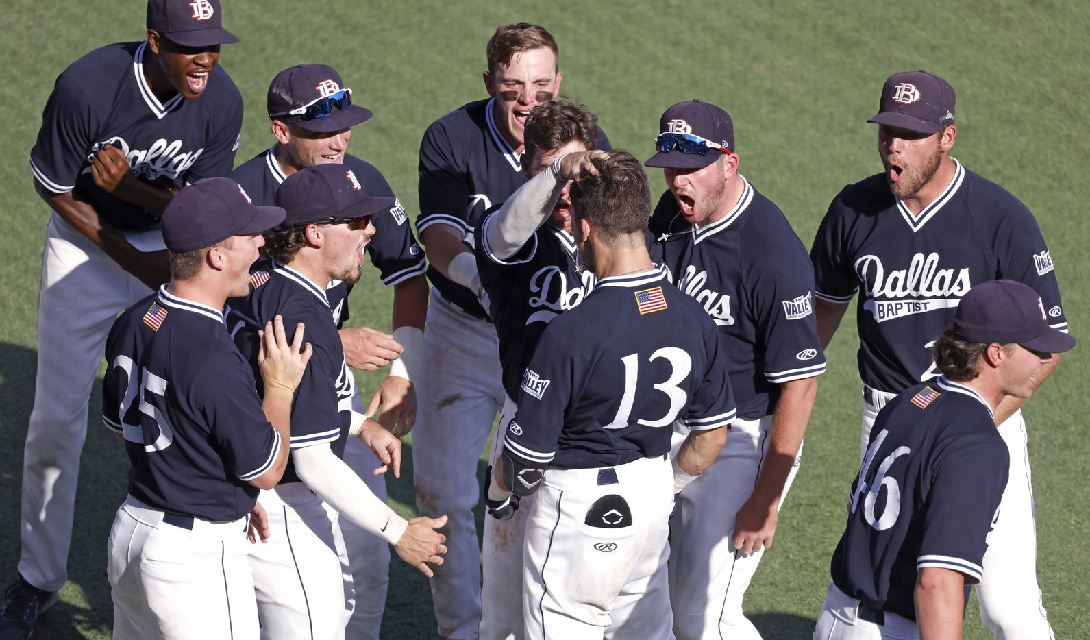 Dallas Baptist infielder Andrew Benefield (13) celebrates with teammates after hitting a grand slam home run against Oregon St. in the seventh inning during the NCAA Division I Baseball Regional Championship game in Fort Worth, Texas on June 7, 2021. (Ron Jenkins/Special Contributor)
