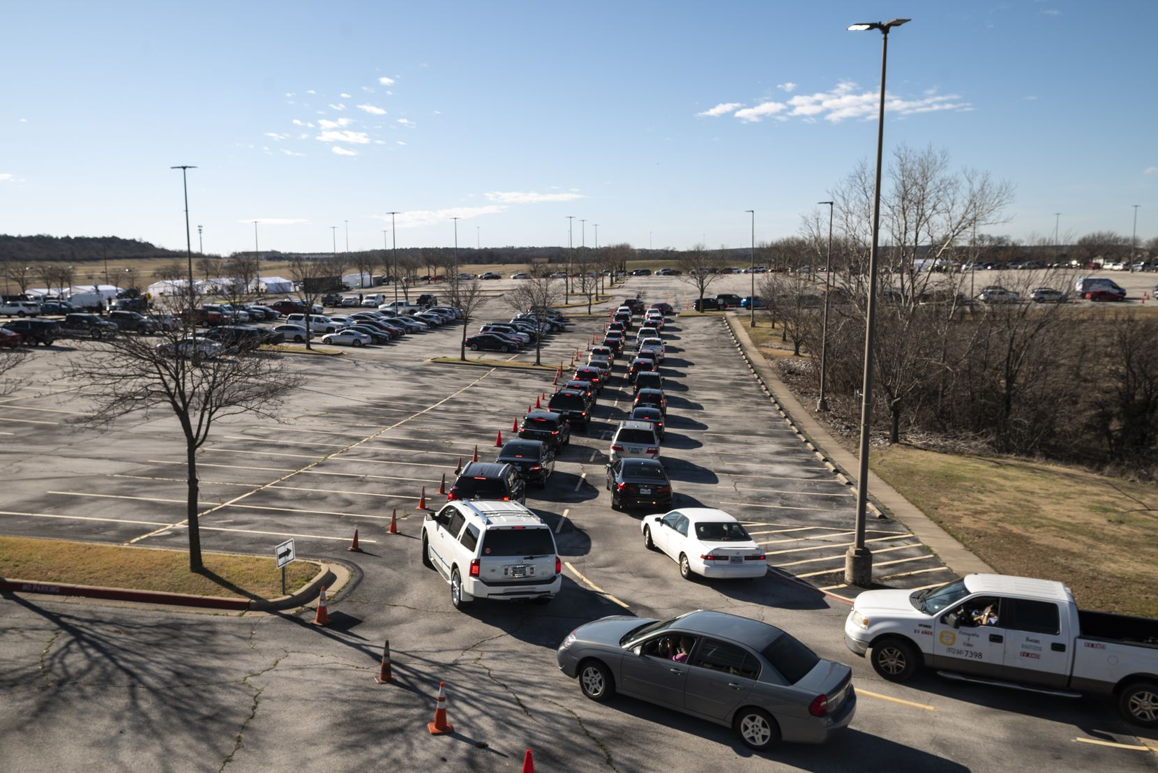 Motorists snaked their way from Keist Boulevard into the parking lots of The Potter's House to receive vaccinations.