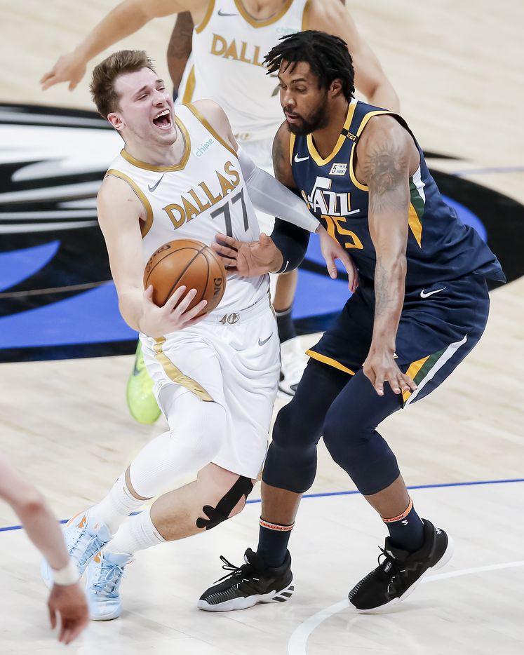Dallas Mavericks guard Luka Doncic (77) battles Utah Jazz forward Derrick Favors (15) for space during the second half of an NBA basketball game in Dallas, Monday, April 5, 2021. (Brandon Wade/Special Contributor)