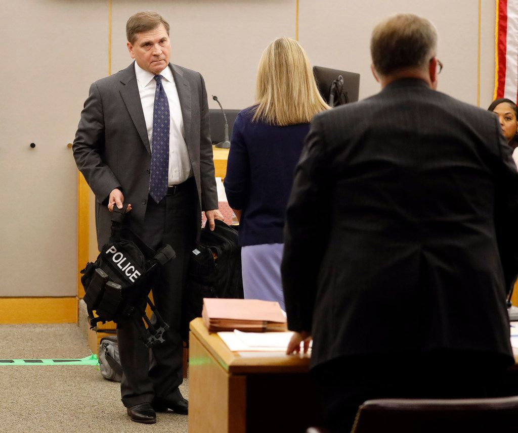 Prosecutor Jason Hermus (right) asks for court to recess as fired Dallas police officer Amber Guyger breaks down in tears during her trial Friday. (Tom Fox/Staff Photographer)