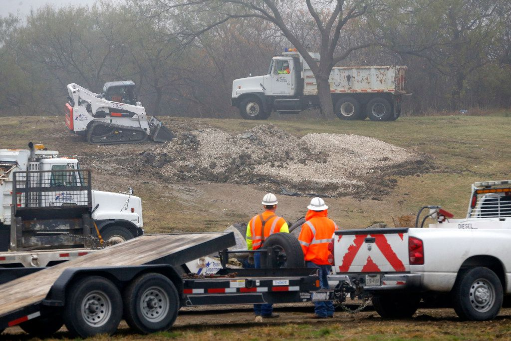 Texas Department of Transportation crews razed the imprint of an iconic Texas-shaped sign on a hillside median off Interstate 20 between Mountain Creek Parkway and Spur 408 in southwest Dallas on Dec. 13, 2016. The sign was removed because of safety concerns, since visitors drove off the road to get to the sign and had to merge back onto the interstate without an entrance ramp.
