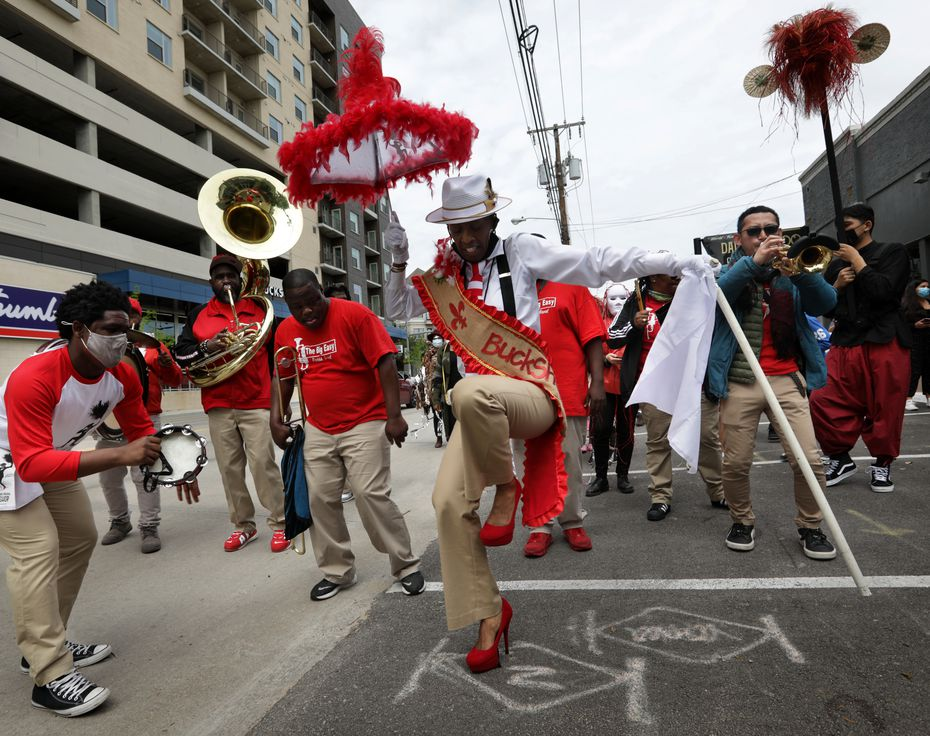 """""""¡Soltar!"""" grandmaster and choreographer Michelle Gibson steps lively in a procession to the Latino Cultural Center."""
