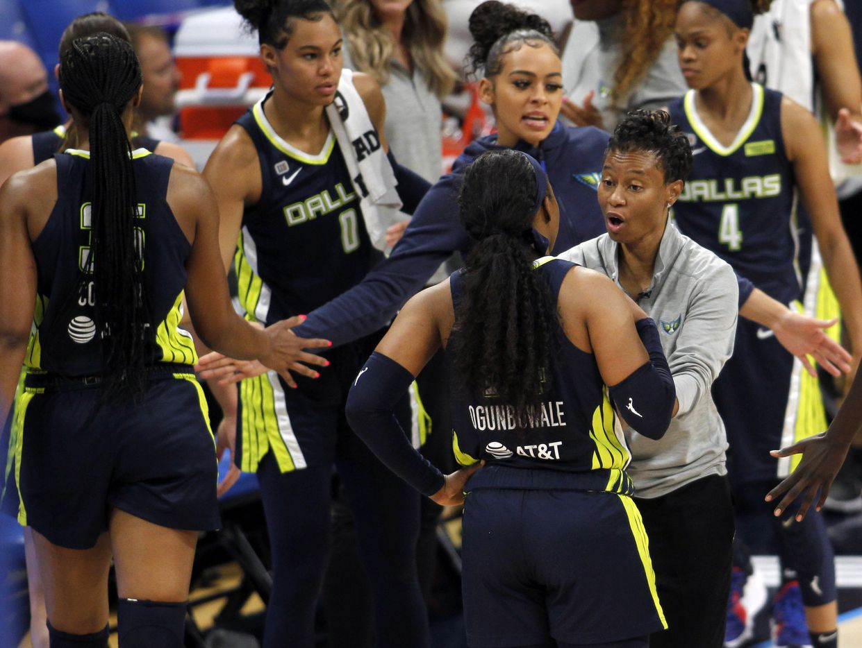 Dallas Wings head coach Vickie Johnson has a word with Wings guard Arike Ogunbowale (24) as players come to the team bench area for a called timeout during the first half of their game against the Las Vegas Aces. The two WNBA teams played their game at College Park Center on the campus of UT-Arlington on July 11, 2021. (Steve Hamm/ Special Contributor)