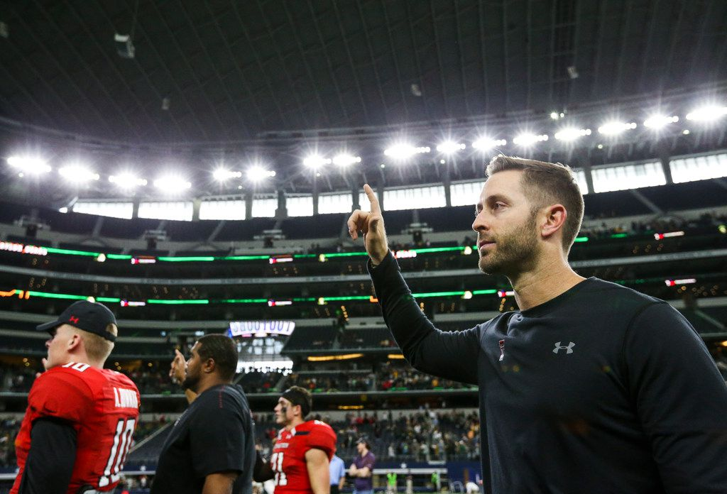 Texas Tech Red Raiders head coach Kliff Kingsbury holds up the Red Raiders hand following Texas Tech's 35-24 loss to Baylor on Saturday, Nov. 24, 2018 at AT&T Stadium in Arlington, Texas. (Ryan Michalesko/The Dallas Morning News)
