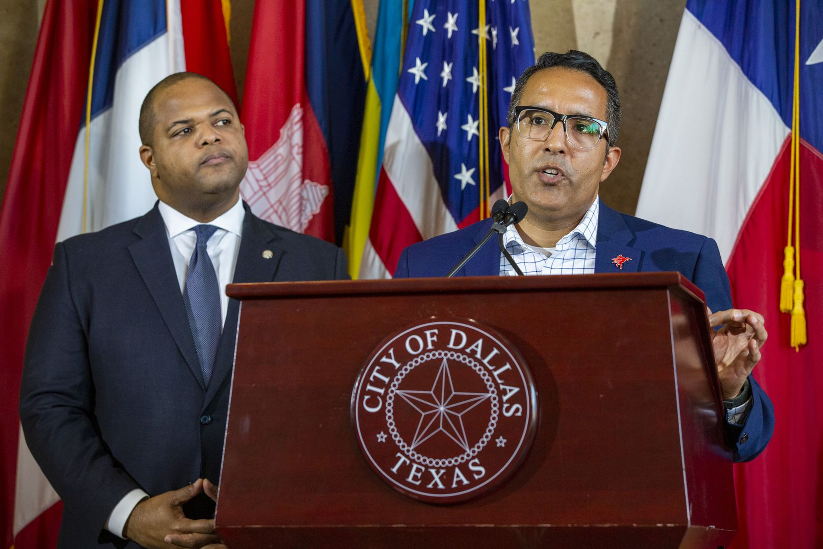 Assistant City Manager Joey Zapata (right) and Mayor Eric Johnson address the cancellation of the St. Patrick's Parade and block party -- related to precautionary measures in light of COVID-19 cases in Dallas County this week -- during a press conference at Dallas City Hall in Dallas on Wednesday, March 11, 2020.