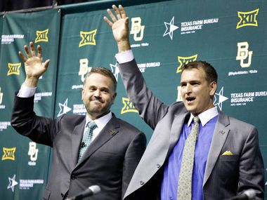 Baylor University introduced its new head football coach Matt Rhule (left) as he and Athletic Director Mack Rhoades (right) do the Sic'em Bears hand gesture during a public ceremony at the Ferrell Center in Waco, Texas, Wednesday, December 7, 2016. Rhule led the Temple Owls to another American Athletic Conference championship before accepting the Baylor offer to be it's 27th head football coach. (Tom Fox/The Dallas Morning News)