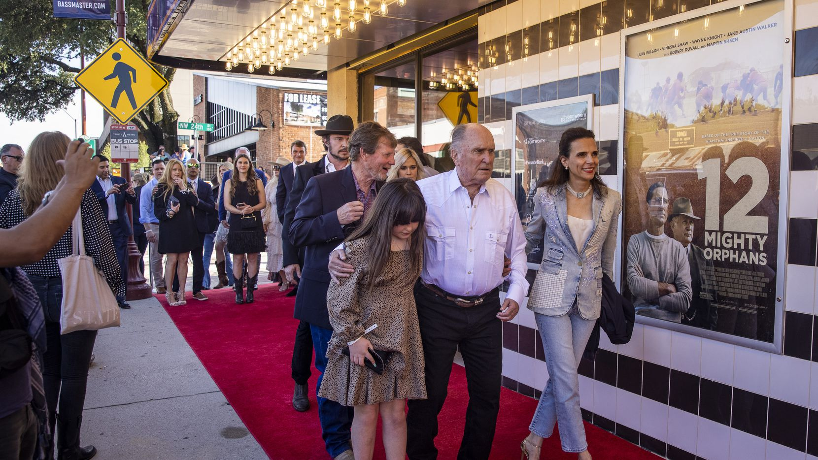"""Actor Robert Duvall, center, attends the premiere of """"12 Mighty Orphans"""" held at the ISIS Theater in Fort Worth, Texas, on Monday, June 7, 2021. The movie stars Academy Award winner Robert Duvall and Dallas' own Luke Wilson, who is the movie's leading man. The film tells the story of the 1930s-era football team from Fort Worth that captured national attention during its Cinderella season. (Lynda M. González/The Dallas Morning News)"""