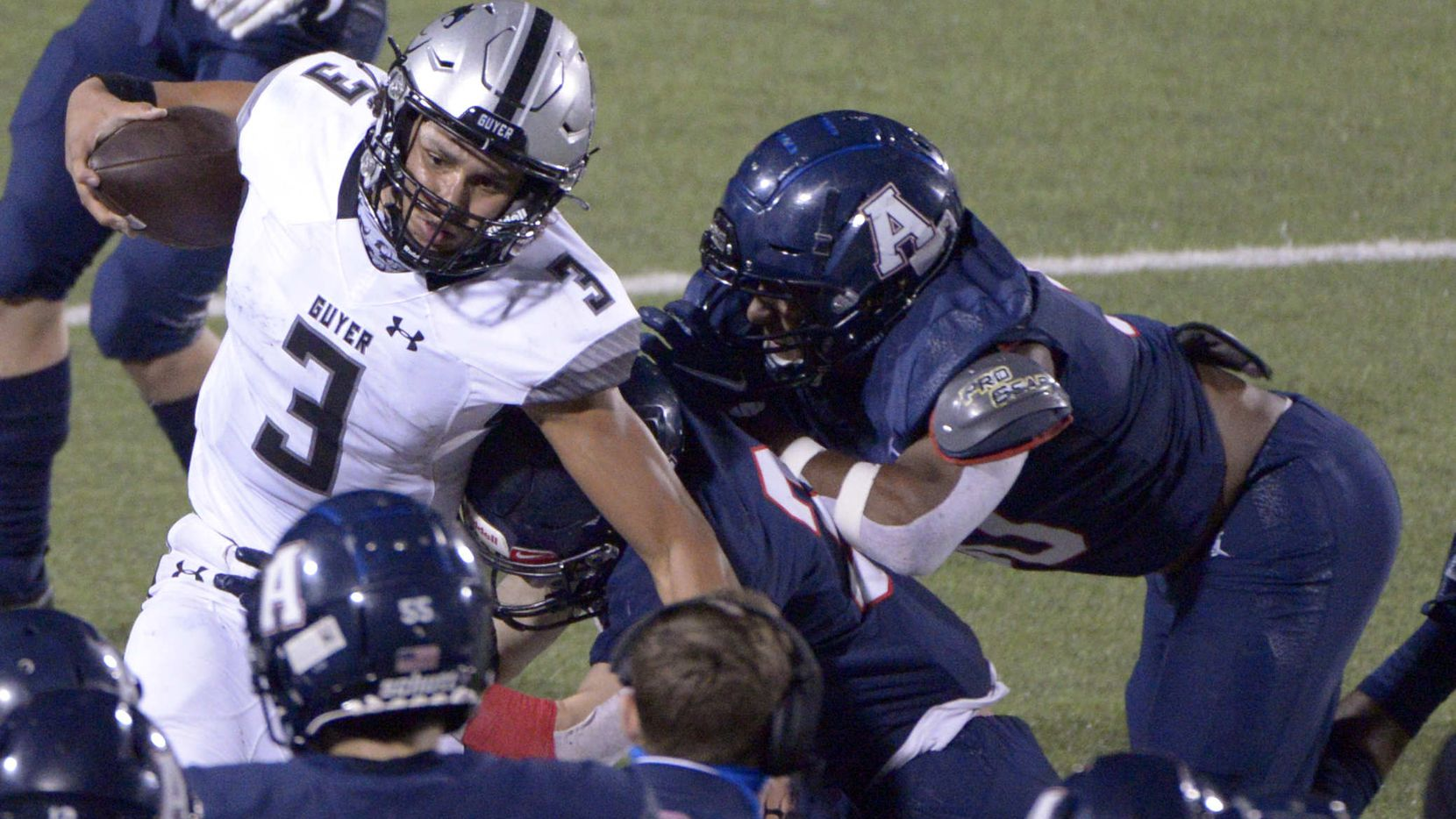 Deton Guyer quarterback Eli Stowers is tackled along the sidelines in the fourth quarter of a high school football game between Denton Guyer and Allen, Friday, Nov. 13, 2020, in Allen, Texas. (Matt Strasen/Special Contributor)