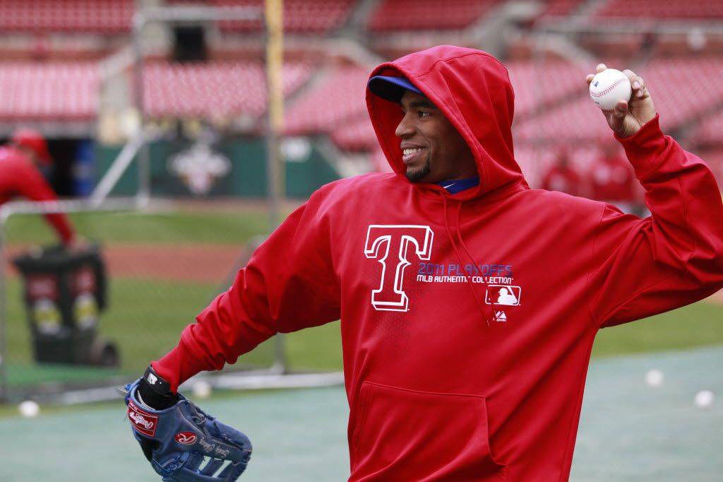 Texas Rangers player Endy Chavez, tries to stay warm while  throwing during practice, prior to Game 6 of the World Series against the St. Louis Cardinals at Busch Stadium in St. Louis, on Thursday, Oct. 27, 2011. (Michael Ainsworth/The Dallas Morning News)