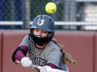 Heritage pitcher Jensin Hall (51) pops out on a bunt attempt in the second inning as Heritage High School hosted Memorial High School for the District 9-5A softball championship in Frisco on Tuesday, April 20, 2021.
