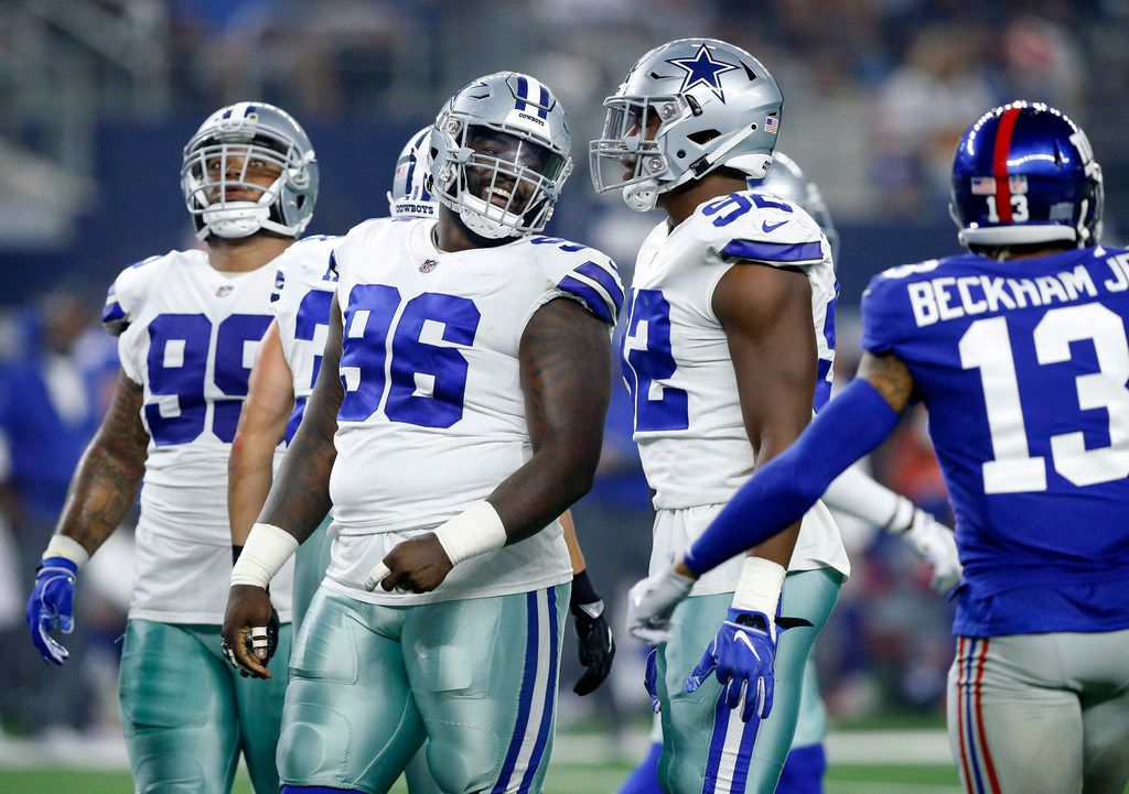 Dallas Cowboys defensive tackle Maliek Collins (96) laughs at New York Giants wide receiver Odell Beckham (13) during the first quarter at AT&T Stadium in Arlington, Texas, Sunday, September 16, 2018. (Tom Fox/The Dallas Morning News)