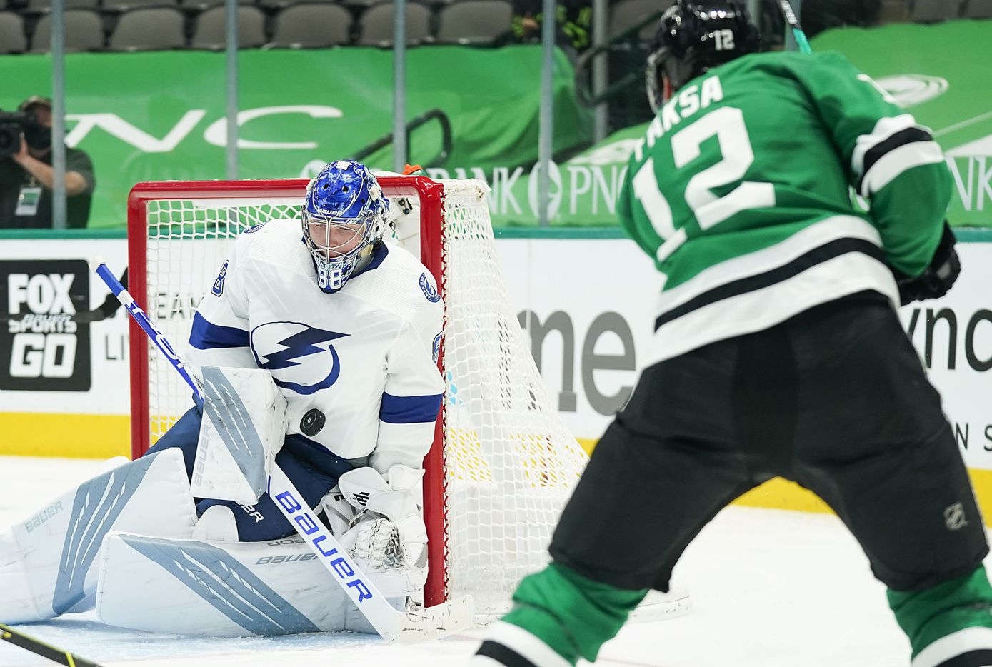 Tampa Bay Lightning goaltender Andrei Vasilevskiy (88) makes a save on a shot by Dallas Stars center Radek Faksa (12) during the third period of an NHL hockey game at the American Airlines Center on Thursday, March 25, 2021, in Dallas. The Stars won the game 4-3. (Smiley N. Pool/The Dallas Morning News)