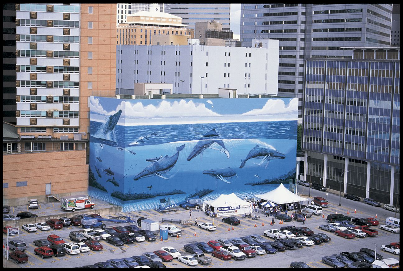 """This is a photograph of """"Whaling Wall 82,"""" found at 505 N. Akard St. in Dallas and painted by the artist Wyland. The mural recently resurfaced, when outdoor advertising that had covered it for years disappeared. Wyland's murals around the world can be seen at www.wylandfoundation.org"""