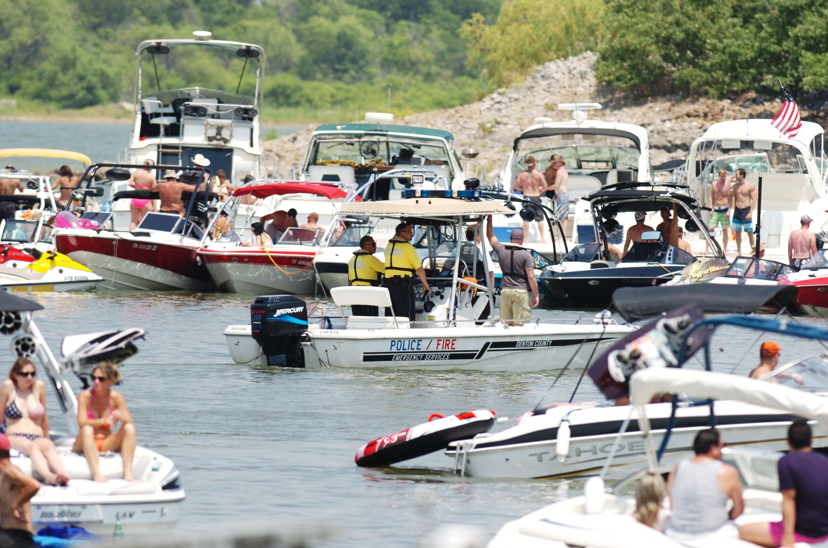 "Lewisville Lake boasts some of North Texas' most infamous ""party coves,"" where boaters like to congregate. In this July 2013 photo, Denton County law enforcement patrolled one of the gathering spots."