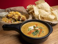 The top selling items at Torchy's Tacos are the green-chile queso and the Trailer Park taco — which is made with fried chicken, green chiles, lettuce, pico de gallo and shredded cheese, served in a tortilla. Torchy's CEO expects to open three new restaurants in Dallas-Fort Worth in 2021.