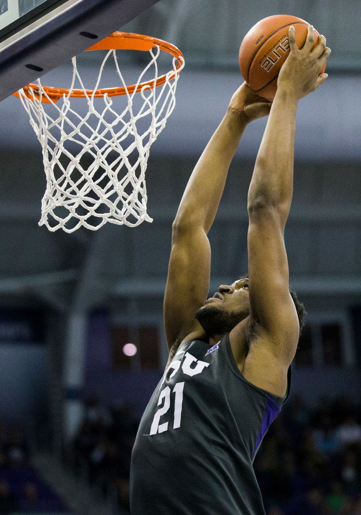 TCU Horned Frogs center Kevin Samuel (21) dunks the ball during the second half of an NCAA mens basketball game between Baylor and TCU on Saturday, February 29, 2020 at Ed & Rae Schollmaier Arena on the TCU campus in Fort Worth. (Ashley Landis/The Dallas Morning News)