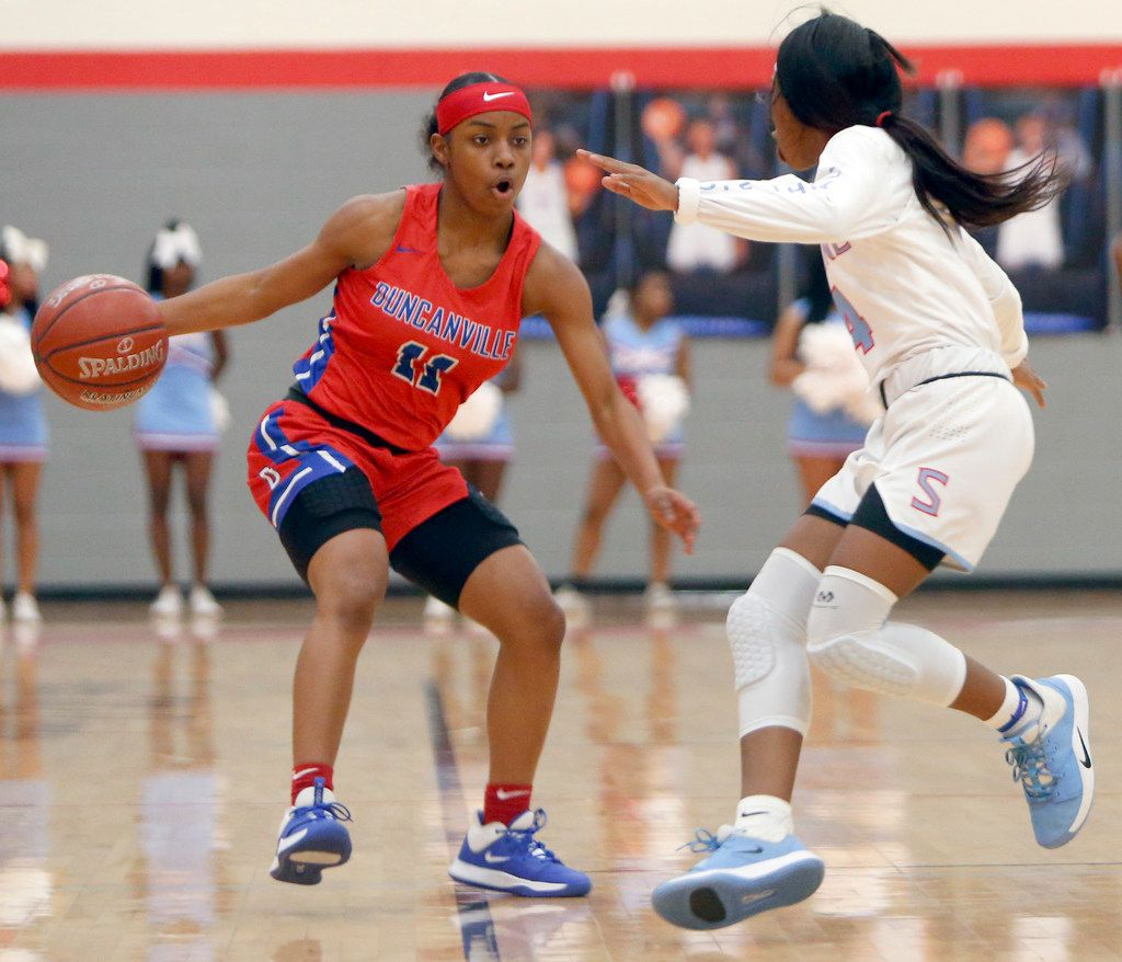 Duncanville's Tristen Taylor (11) drives against the defense of Dallas Skyline's Kennedi Johnson (4) during first half action. The two teams played their girls basketball game at  Skyline High School in Dallas on January 7, 2020. (Steve Hamm/ Special Contributor)