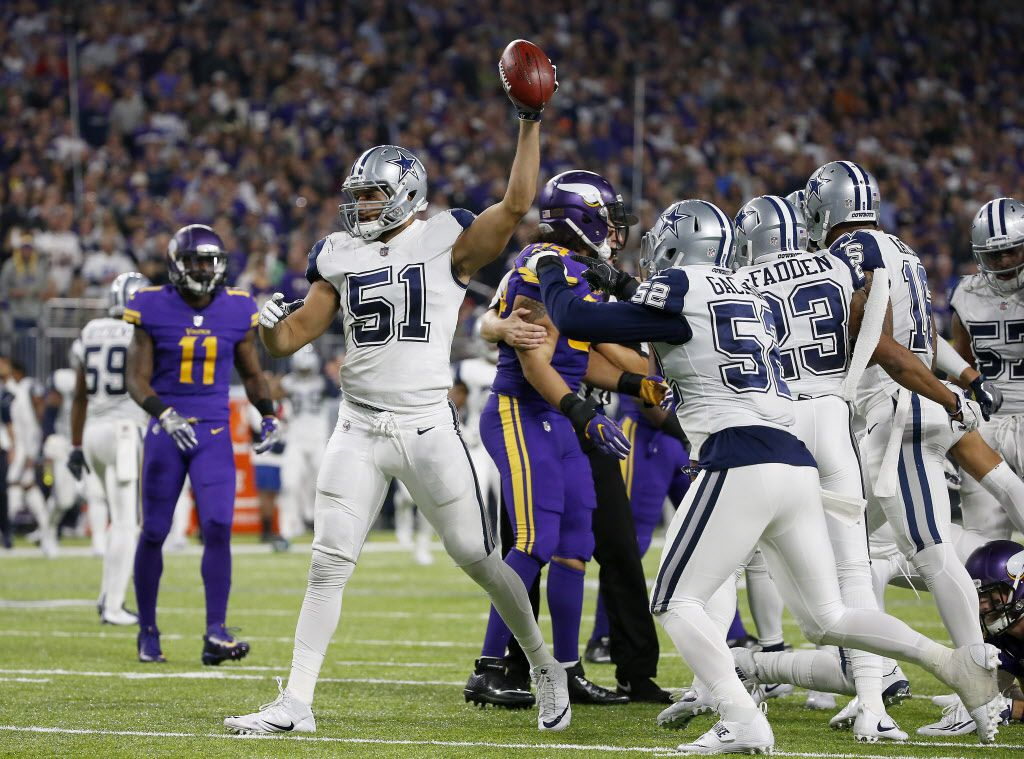 Dallas Cowboys outside linebacker Kyle Wilber (51) raises the ball after he recovers a fumble by Minnesota Vikings wide receiver Adam Thielen (19) on the punt return during the fourth quarter at U.S. Bank Stadium in Minneapolis, Thursday, Dec. 1, 2016. Dallas Cowboys won 17-15. (Jae S. Lee/The Dallas Morning News)