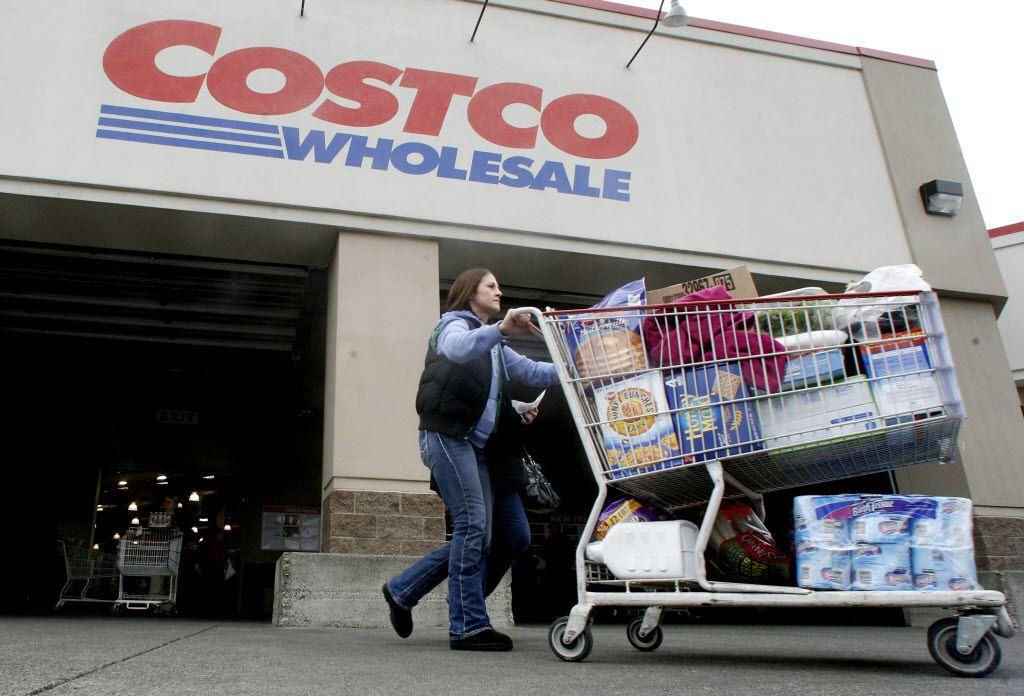 FILE- In this Wednesday, Dec. 7, 2011, file photo, a shopper leaves a Costco store in, Portland, Ore. Many companies are making special end-of-year dividend payments or moving up their quarterly payouts because investors will have to pay higher taxes on dividend income starting in 2013, unless Congress and President Barack Obama reach a compromise on taxes and government spending. (AP Photo/Rick Bowmer, File) 12132012xBRIEFING 05102013xBIZ 07122013xBIZ 07122013xBIZ