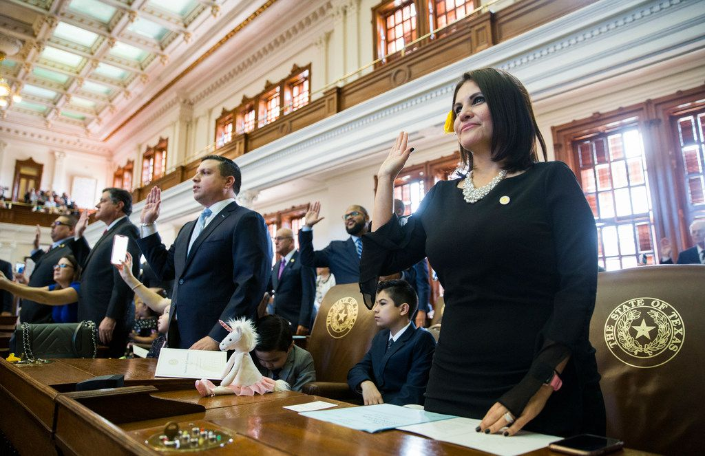 Representative Ana-Maria Ramos, right, is sworn in on opening day of the 86th Texas legislature on Tuesday at the Texas state capital in Austin.