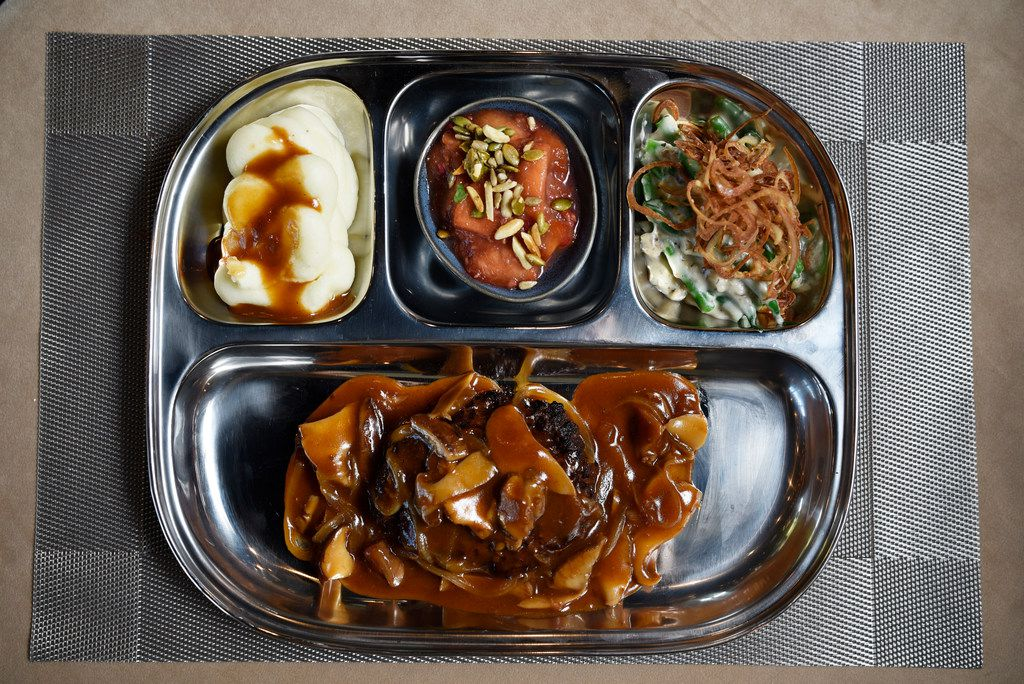 Swankson's No TV Lunch with Yoakum Wagyu Salisbury steak from Ellie's restaurant, prepared at a test kitchen in west Dallas, Aug. 12, 2019. Ben Torres/Special Contributor
