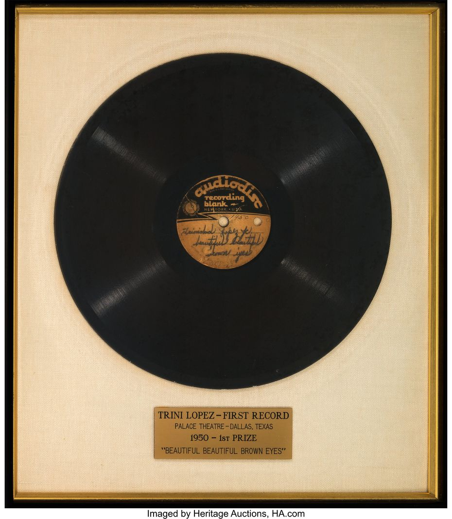 """A framed acetate of Trini López's first recording, """"Beautiful, Beautiful Brown Eyes"""" is among the items being sold."""