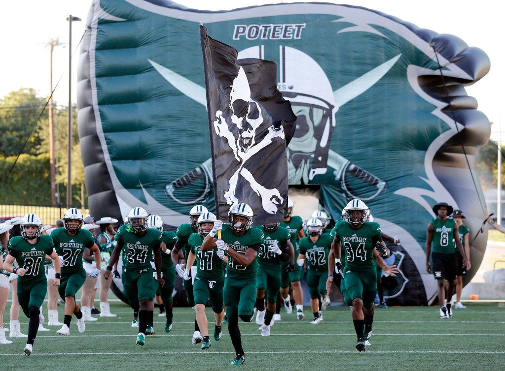 The Poteet Pirates take the field before the start of a high school football game against Denton Ryan at Memorial Stadium in Mesquite, Friday, August 31, 2018. (John F. Rhodes / Special Contributor)