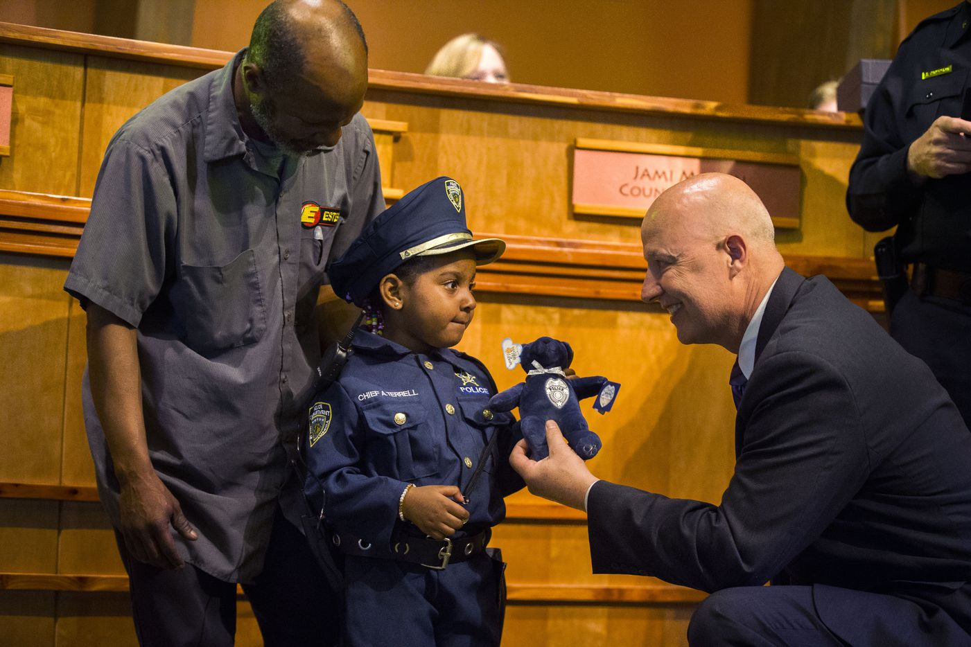 """Four-year-old Ah'Maya Terrell received a stuffed animal from Ely Reyes, the incoming Cedar Hill police chief, after Ah'Maya was designated as the Cedar Hill Police Department's """"chief for a day"""" during a City Council meeting on March 26, 2019."""
