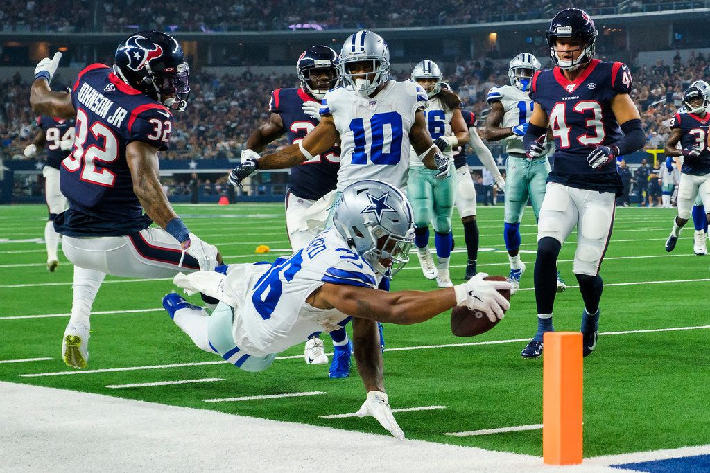 Dallas Cowboys running back Tony Pollard comes up just short as he dives for the end zone past Houston Texans cornerback Lonnie Johnson (32) and safety Chris Johnson (43) during the first quarter of an NFL preseason football game at AT&T Stadium on Saturday, Aug. 24, 2019, in Arlington, Texas.
