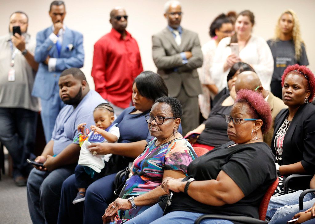 John Nolley Jr's mother Alice Samuel (seated front, right) and her sister Linda Smith (second from right), listen to John speak during a press conference at the Tim Curry Criminal Justice Building in downtown Fort Worth, Wednesday, October 3, 2018.