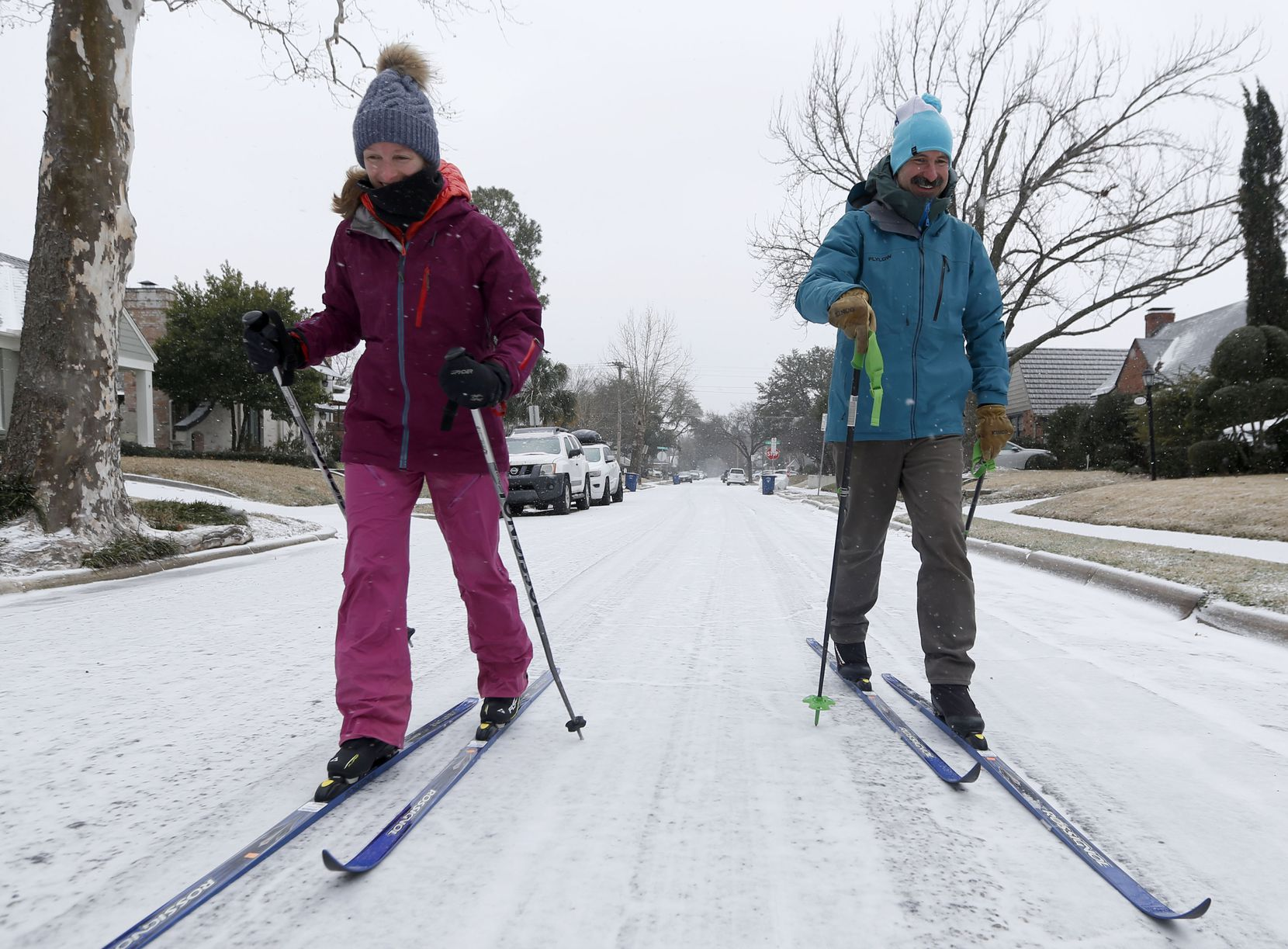 With the afternoon temperature hovering around 18 degrees F, with a wind chill of 4, Caroline and Peter Clark, of East Dallas, embrace the snowy Valentines Day weather by cross country skiing together in their Cochran Heights neighborhood, Sunday, Feb. 14, 2021 in Dallas. As temperatures dropped to near-record lows Sunday, electricity operators warned that demand could overwhelm the state's power grid and force rotating power outages.