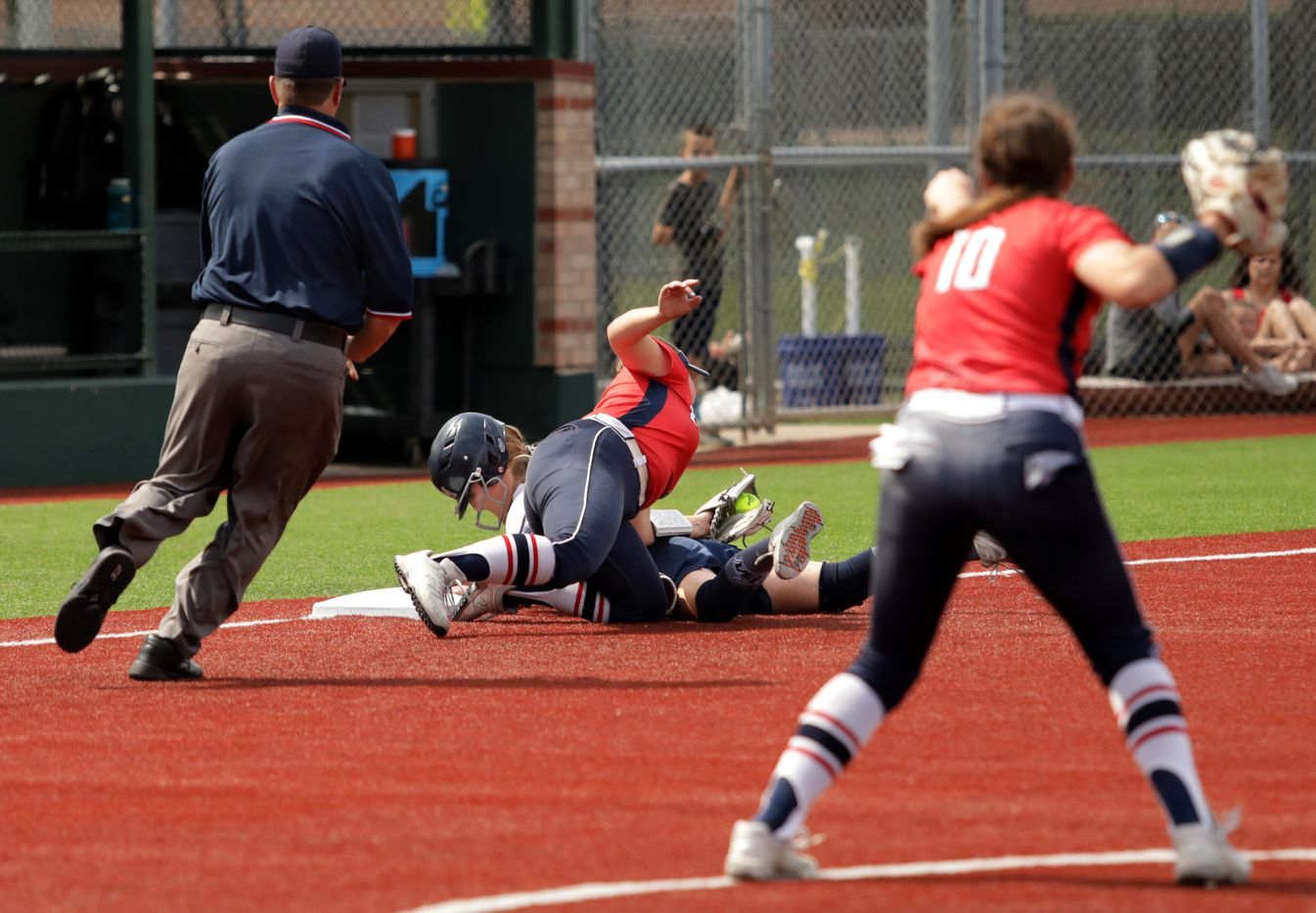 Flower Mound High School player #6, McKenna Andrews, slides into third base as Allen High School player #8, Taylor Wright, attempts to get her out during a softball playoff game at Allen High School in Allen, TX, on May 15, 2021. (Jason Janik/Special Contributor)