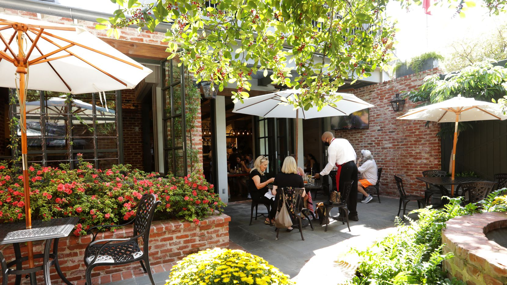 The patio at S&D Oyster Company in Uptown Dallas is a quiet, comfortable spot that feels straight out of New Orleans.