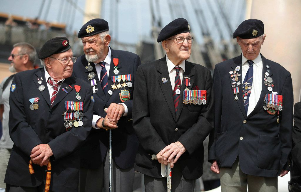 D-Day veterans gather during a D-Day commemoration event at the Historical Dockyard in Portsmouth, southern England, Sunday June 2, 2019. There are many events over the coming days to mark the 75th anniversary of the landings by the Allied forces on Tuesday June 6, 1944, in Normandy, France, that became known as D-Day.